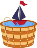 Toy boat in a bathtub barrel Stock Photos