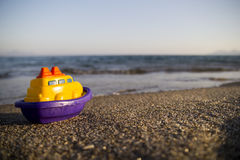 Toy boat on the beach Royalty Free Stock Image