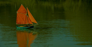 Toy boat on a lake. A toy boat taken on the pond at Wattlehurst Farm Royalty Free Stock Image