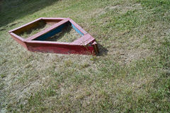 Toy boat on playground with grass Royalty Free Stock Images