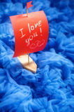 Toy boat with red sails on blue background. love you. Stock Photography