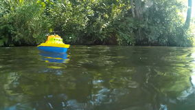 Toy boat on the river stock video