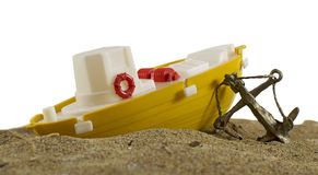 Toy boat on sand Royalty Free Stock Photo