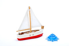 Toy boat and shell. Child's toy boat with blue shell royalty free stock image