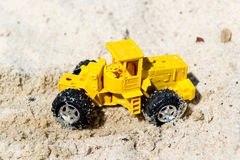 Toy boat in the wet sand of the sea. Summer holidays at sea. Boat trips. Royalty Free Stock Photo