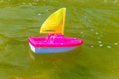 Toy boat in the wet sand of the sea. Summer holidays at sea. Boat trips. Stock Photo
