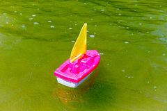 Toy boat in the wet sand of the sea. Summer holidays at sea. Boat trips. Stock Images