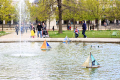 Toy boats in the fountain in the Park of Paris. Toy boats with colorful sails in the fountain in the Park of Paris royalty free stock photos