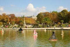 Toy boats in the Luxembourg Garden. Of Paris, France. The pirate boat on the first plan stock images