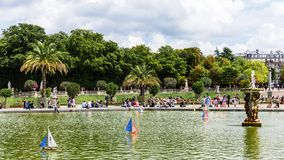 Toy boats in a pond in the Luxembourg Gardens Jardin du Luxembo. Paris, France - Jule 11, 2017: Colorful toy boats race on the water in a pond in the Luxembourg Stock Images