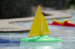 Toy boats  in a pool Royalty Free Stock Images