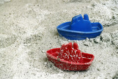 Toy boats in a sandbox. An image of two toy boat in a children playground sandbox royalty free stock image