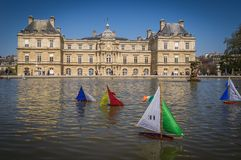 Toy boats in a fountain in Paris Stock Photography