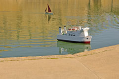 Toy boats on water Royalty Free Stock Image