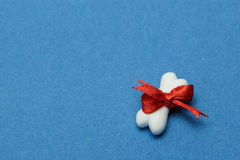 Toy a bone from plasticine Stock Photography