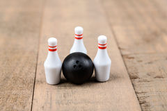 Toy bowling ball and pins Stock Photos