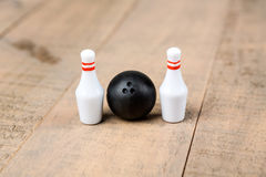 Toy bowling ball and pins Stock Images