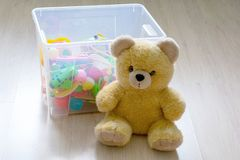 Toy Box full of soft toys in a child`s bedroom royalty free stock photo