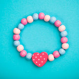 Toy bracelet with heart shape Royalty Free Stock Photography