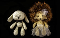 Toy braided newlyweds, the bride and groom on a black background Stock Photo