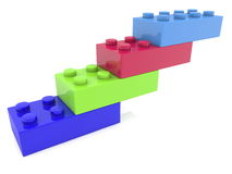 Toy bricks in four colors on white Royalty Free Stock Photo