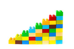 Toy bricks shape as a growing trend on white Royalty Free Stock Images