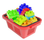 Toy bricks in shopping basket Stock Photo