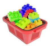 Toy bricks in shopping basket Stock Photo
