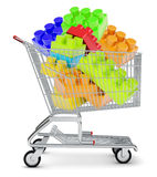 Toy bricks in shopping cart Stock Photo