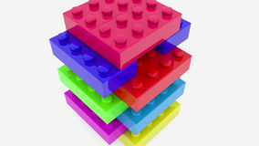 Toy bricks in various colors stacked on white stock video