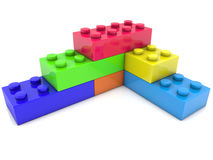 Toy bricks in various colors on white Stock Photos