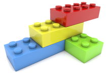 Toy bricks in various colors on white Royalty Free Stock Photos