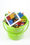 Toy Bucket. Green toy bucket which is full with different and colored toys Royalty Free Stock Photos