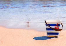 Toy bucket on a beach background Royalty Free Stock Image