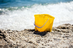 Toy bucket on beach. Royalty Free Stock Images
