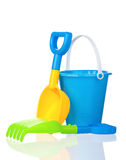 Toy bucket, rake and spade Royalty Free Stock Images