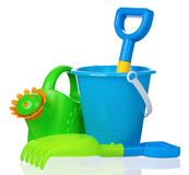Toy bucket, rake and spade Royalty Free Stock Photo