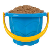 Toy bucket with sand. Blue plastic toy bucket with sand isolated on white stock photo