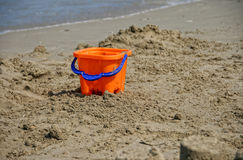 Toy Bucket on Sand. A blue and orange toy bucket on a beach Stock Image