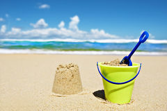 Toy bucket and shovel on the beach Stock Images