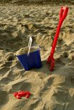 Toy Bucket and Spade on Beach Stock Photography