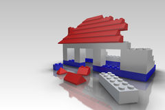 Toy Building Block House Under Construction. House made from toy building blocks under construction Royalty Free Stock Photography