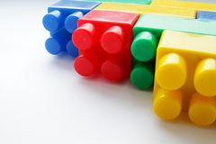 Toy building blocks on the table. Image of toy building blocks on the table stock photography