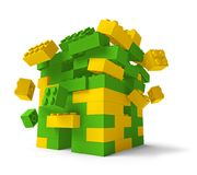 Toy building blocks tower collapsing 3D. Toy building blocks fortress tower collapsing 3D isolated on white, low angle Stock Images