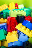 Toy building colorful blocks on green box. Stock Photo