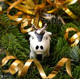 The Toy Bull on Fir tree. Royalty Free Stock Photos