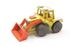 Toy Bulldozer. Hard working toy bulldozer on white background Royalty Free Stock Images