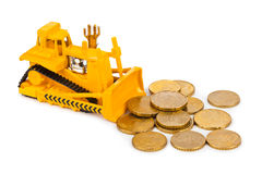 Toy bulldozer and money coins Stock Photo