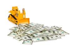 Toy bulldozer and money Royalty Free Stock Photos