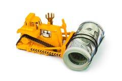 Toy bulldozer and money Royalty Free Stock Photo